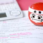 英語のノートとダルマ